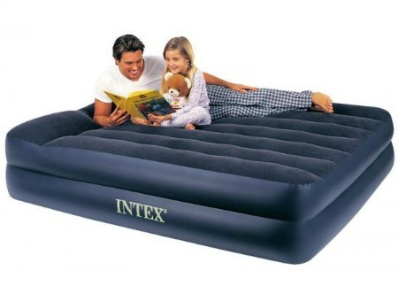 Men and daughter reading on a air mattress.